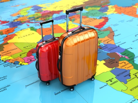 Travel or tourism concept. Luggage on the world map.