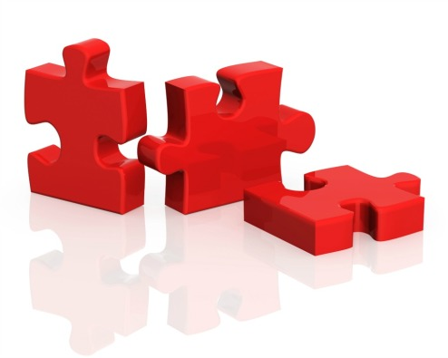 Three parts of a puzzle. Objects over white